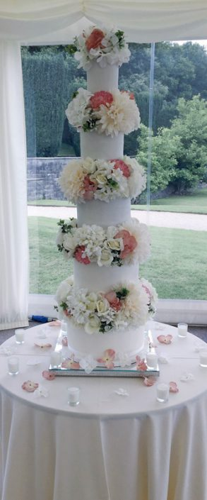 Tall Flower Filled Wedding Cake